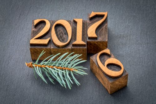 63291937 - new year 2017 replacing the old year 2016 - letterpress wood type printing blocks on a slate stone